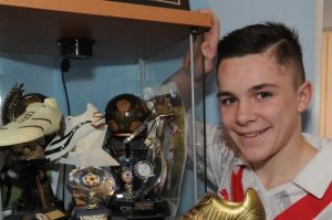 Jordan Allan shows off his trophies. Image: Daily Record.