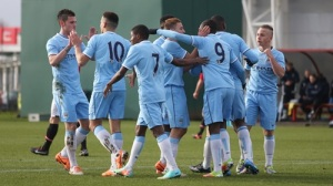 City celebrate their goal.